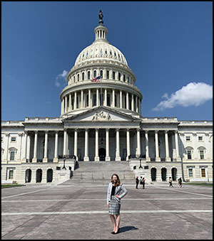 Student in front of capitol building